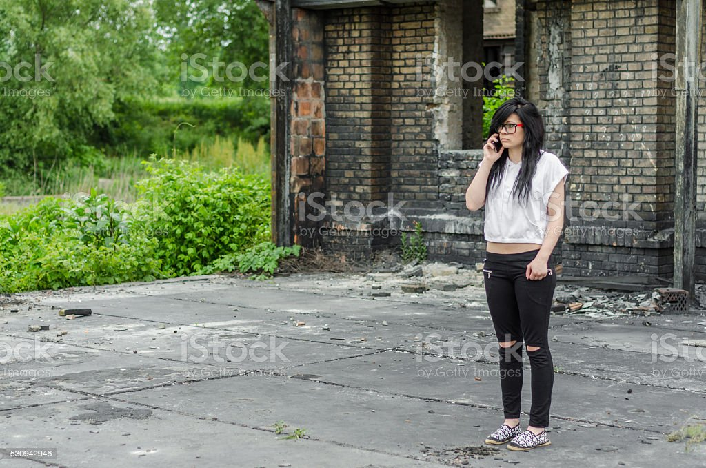 Emo girl talking on the phone stock photo