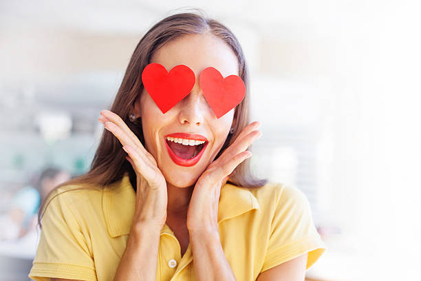 "emoji concept: woman with the hearts instead of her eyes woman with ""emoji"" style hearts of her happy face love at first sight stock pictures, royalty-free photos & images"