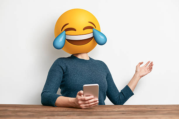 emoji head woman sitting at desk. - emoticons stock photos and pictures