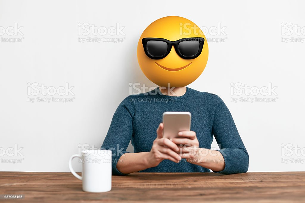 Emoji Head Woman using smart phone stock photo