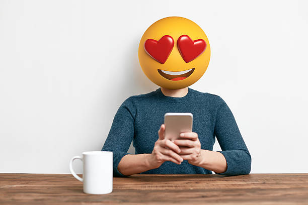 emoji head woman using smart phone - emoticons stock photos and pictures