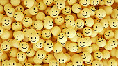 3d rendering of emoji with smiley face. large group of objects. yellow background.
