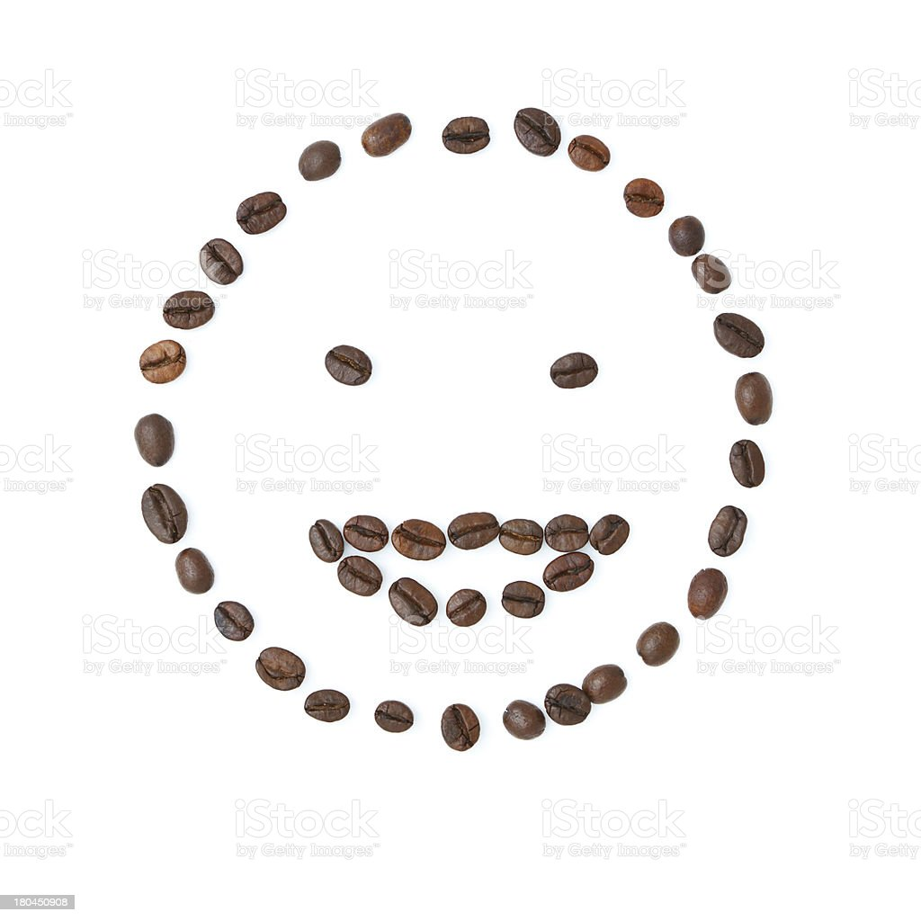 Emoticon smile made of coffee beans royalty-free stock photo