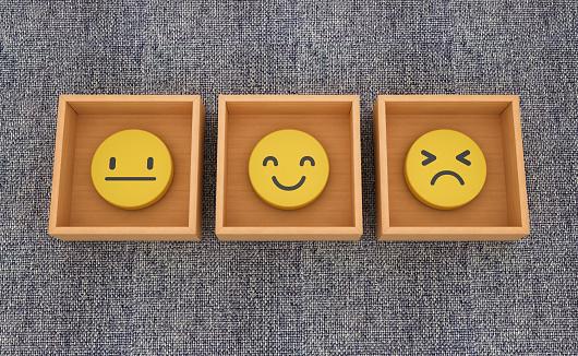 Emoticons Inside Boxes on Blue Carpet - 3D Rendering