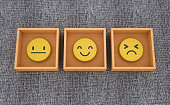 istock Emoticons Inside Boxes on Blue Carpet - 3D Rendering 1250433120