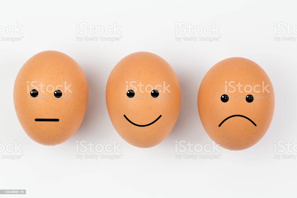 Emotion painted of eggs isolated on white background stock photo