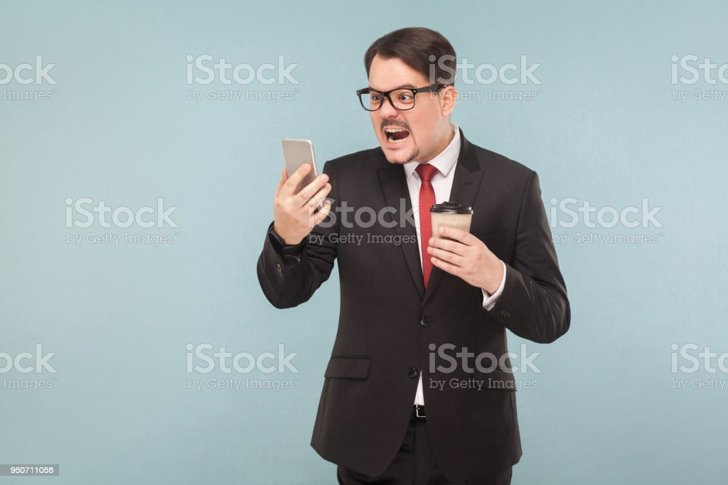 Emotional boss shouts at the interlocutor stock photo
