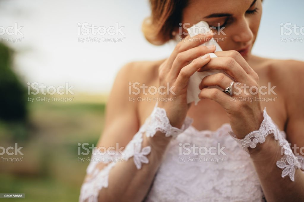 Emotional bride weeps tears of happiness stock photo
