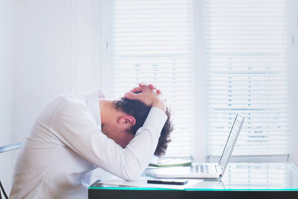 Emotional burnout, tired businessman at workplace in the office, stress. emotional burnout, tired businessman at workplace in the office, stress concept mental burnout stock pictures, royalty-free photos & images