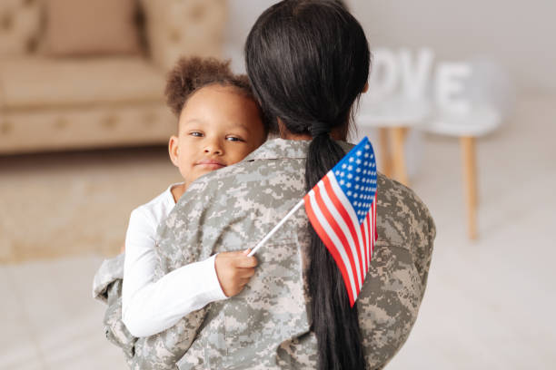 emotional child really happy seeing her mother - armed forces stock photos and pictures