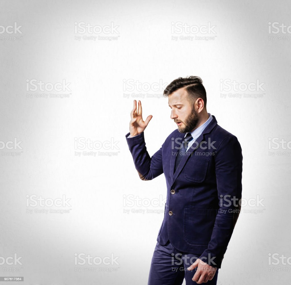 Emotional dialogue of a man in a suit. stock photo