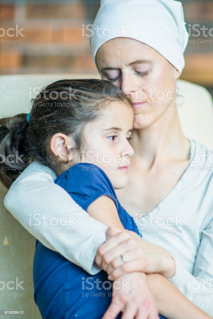 Emotional Hug With Mother and Daughter stock photo