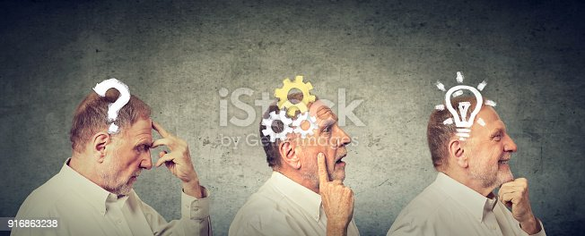 istock Emotional intelligence. Side view of an elderly man thoughtful, thinking, finding solution with gear mechanism, question, lightbulb. 916863238