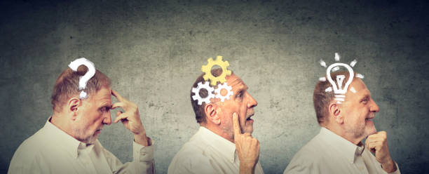 emotional intelligence. side view of an elderly man thoughtful, thinking, finding solution with gear mechanism, question, lightbulb. - reminder stock photos and pictures