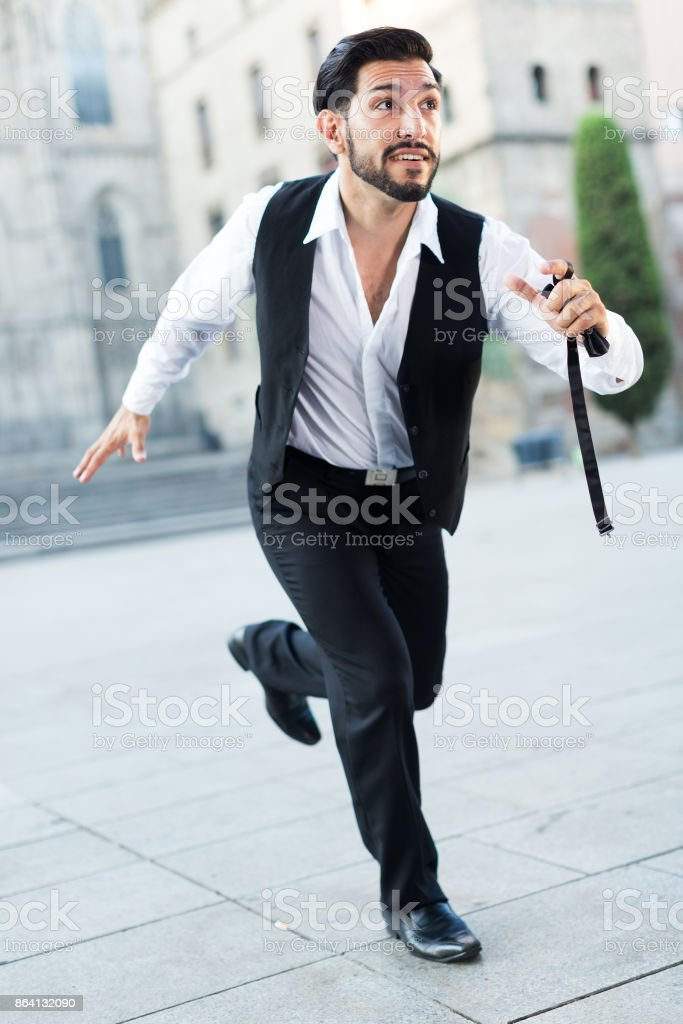 Emotional man in formalwear running royalty-free stock photo