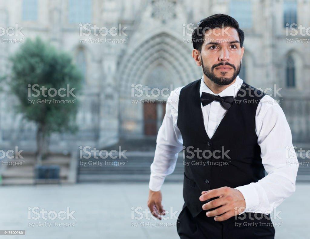 Emotional man in formalwear running stock photo