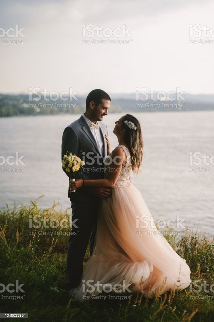 Emotional Picture Of Just Married Couple Standing In Field And
