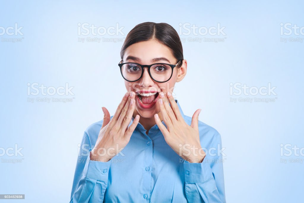 Emotional Portrait of young beautiful business woman in glasses. stock photo