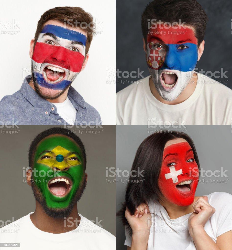 Fãs de futebol emocional com bandeiras pintadas nos rostos - foto de acervo