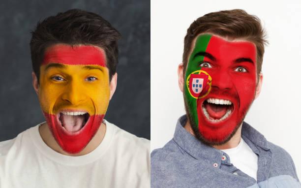 känslomässiga fotbollsfans med målat flaggor på ansikten - football portugal flag bildbanksfoton och bilder