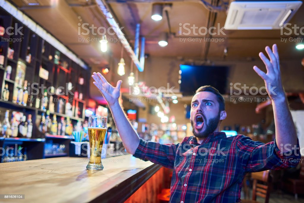 Emotional Sports Fan in Pub stock photo