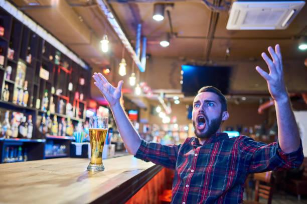 Emotional Sports Fan in Pub stock photo