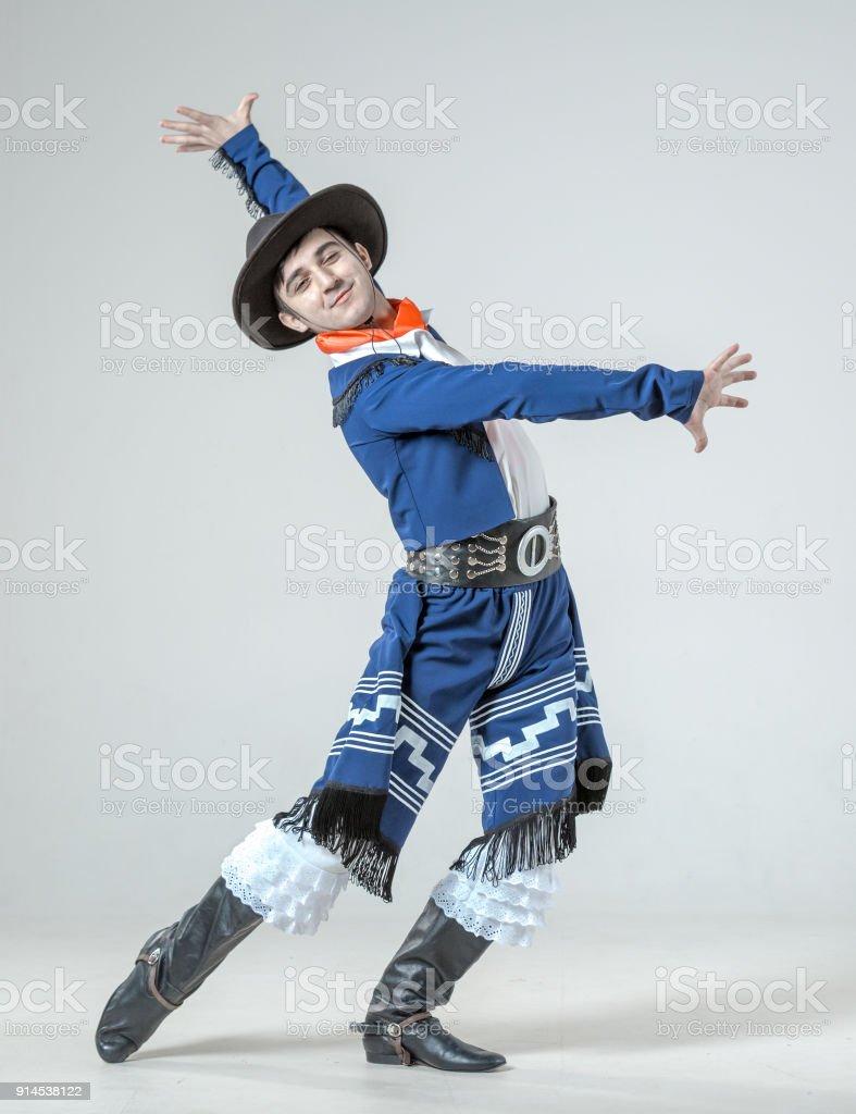 Emotional Young Man Is Dancing Hispanic Dance stock photo