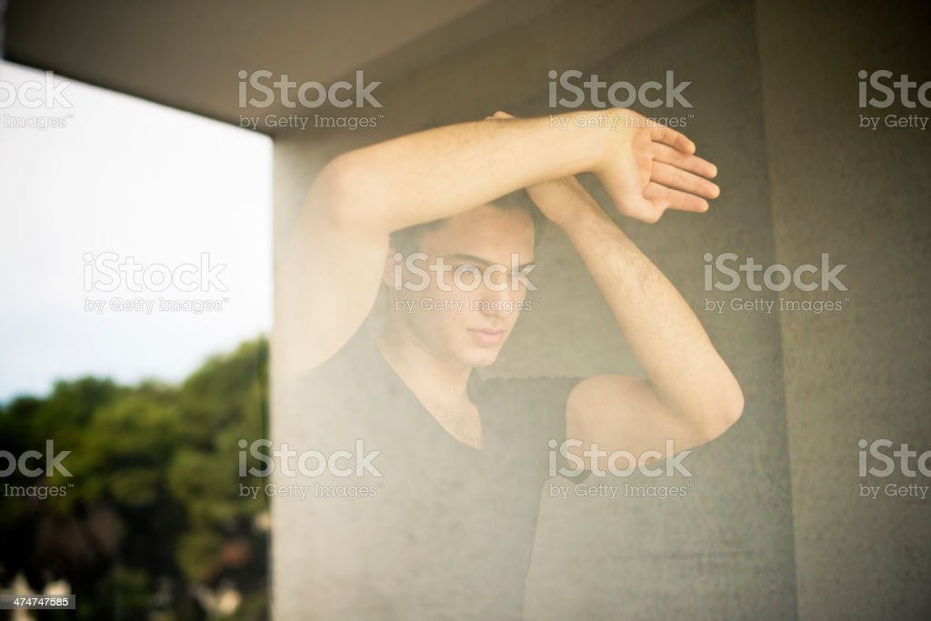 Emotional young man looking through the window. royalty-free stock photo