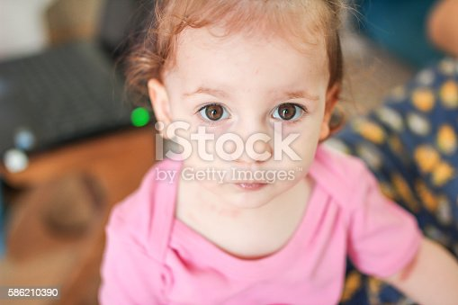 istock Emotionless face expression for a little cute kid 586210390