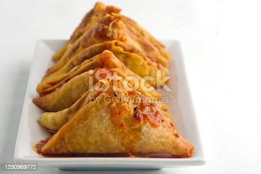 Empanadas. Classic traditional Latin American of Spanish street food favorite. A fried crispy pastry or turnover filed with seasoned meat, garlic herbs and spices served with spicy dipping sauces.