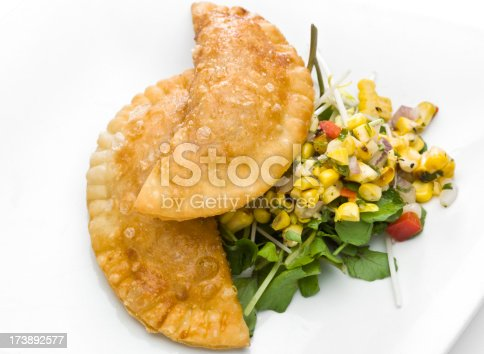Could be cheese empanada, meat empanada or chicken empanada, on white background