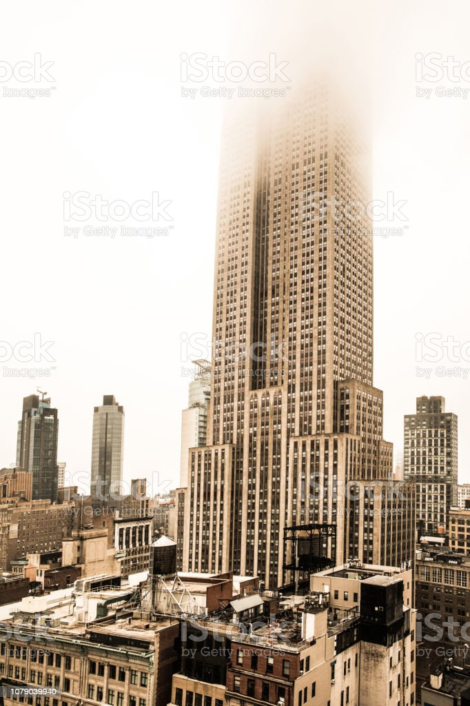 Empire State Building and midtown Manhattan in a foggy winter day in New York stock photo