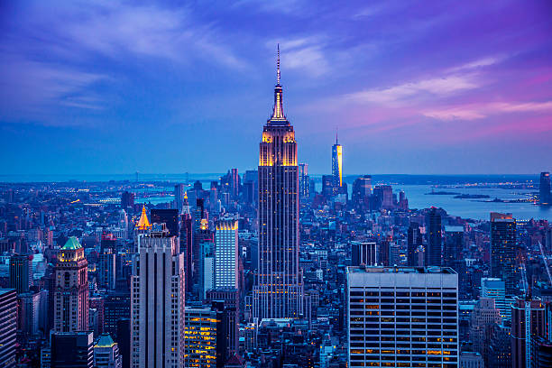 empire state building at night - empire stock pictures, royalty-free photos & images