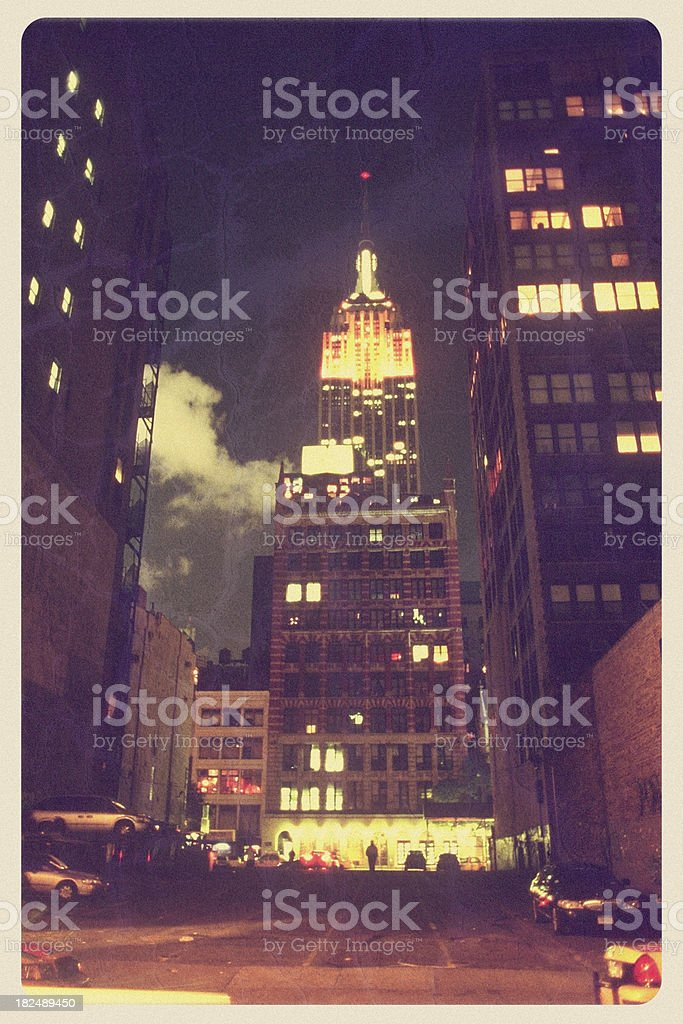 Empire State Building at Night - Vintage Postcard royalty-free stock photo