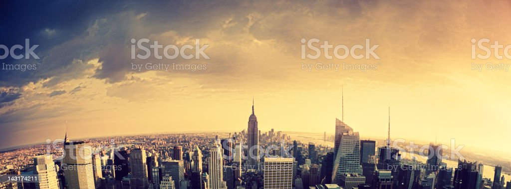 Empire State Building in Manhattan during a dramatic weather royalty-free stock photo