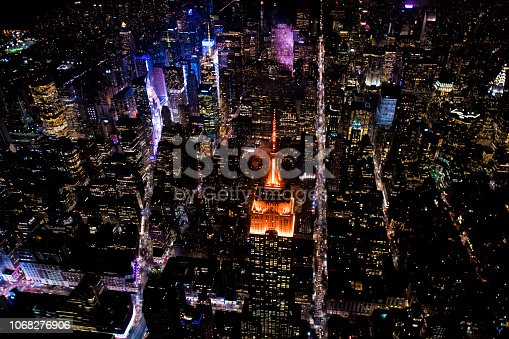 Aerial view of the Empire State Building taken from a helicopter above New York at night time.