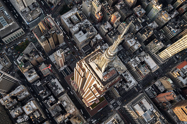 Empire State Building in New York Helicopter point of view of Empire State Building in New York with many details visible in the image. empire state building stock pictures, royalty-free photos & images
