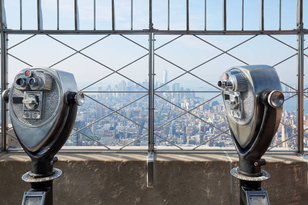 Empire State Building observation deck with two binoculars in a sunny day in New York stock photo