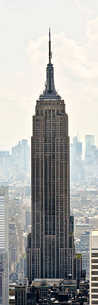 Empire State Building panorama Empire State Building panorama at Manhattan background in NYC empire state building stock pictures, royalty-free photos & images