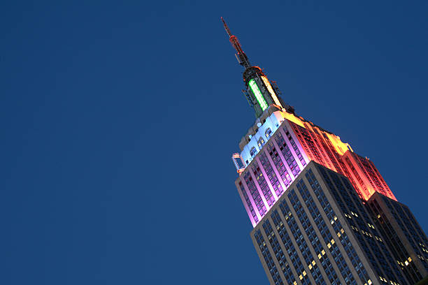 Empire state building Empire state building at NYC pride week, with rainbow colors lighting empire state building stock pictures, royalty-free photos & images