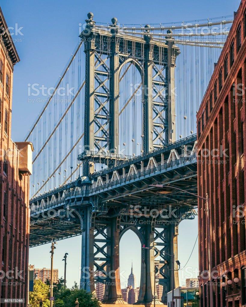 Empire State building through the Manhattan Bridge, NY stock photo