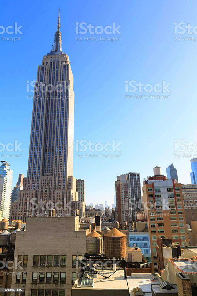 Empire State building with mitown manhattan buildings royalty-free stock photo
