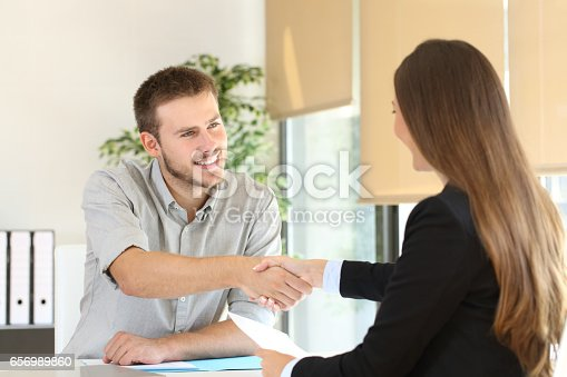 istock Employee and boss handshaking after a job interview 656989860