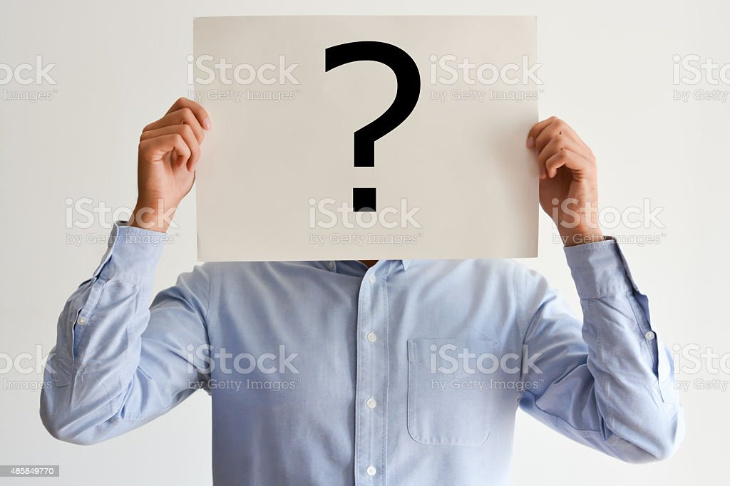 Employee dilemma with question marks on blank paper stock photo