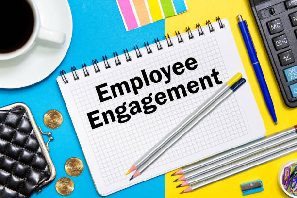 employee engagement notes in the notebook on the desk of a businessman in office. business concept employee engagement. - employee engagement stock photos and pictures