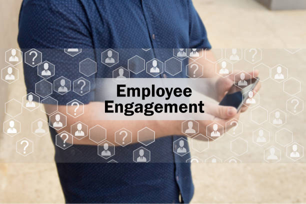 employee engagement   on the touch screen with a blur background of the businessman with the phone.the concept of employee engagement - employee engagement stock photos and pictures