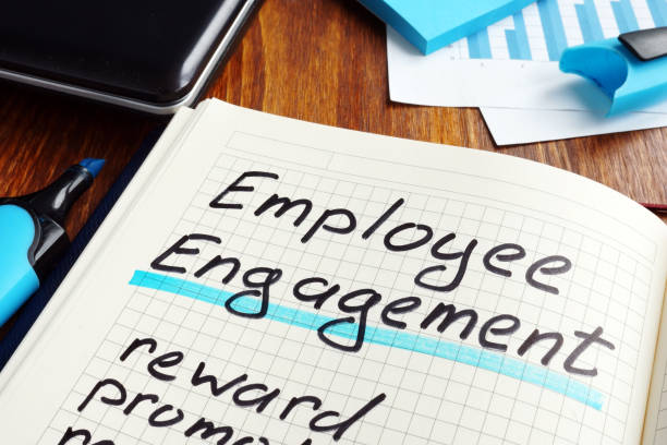 employee engagement plan on a book. engage workers. - employee engagement stock photos and pictures