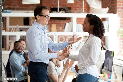 istock Employee getting praise from boss while colleagues applauding 1138949166