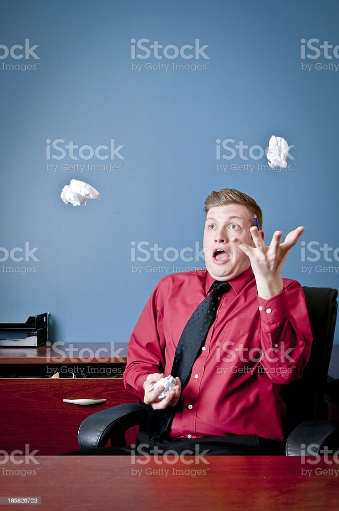 Employee goofing off in his office and juggling stock photo