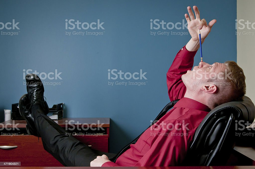 Employee goofing off in his office stock photo